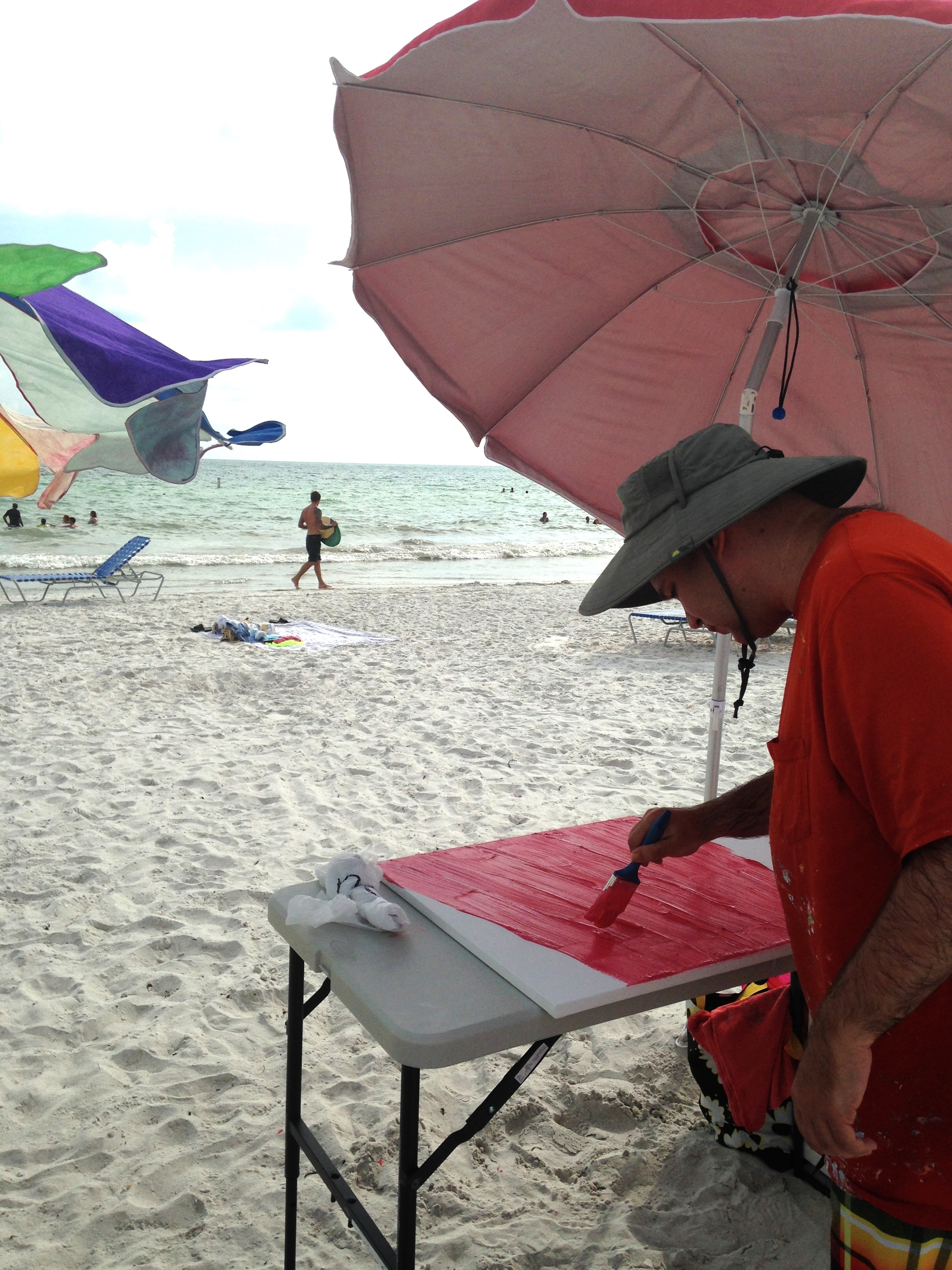 Trent painting on the beach
