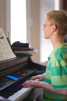 autistic boy piano